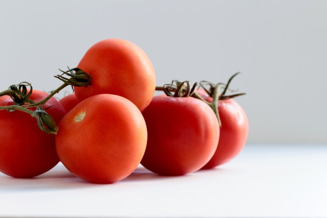 Tomatoes on the white floor