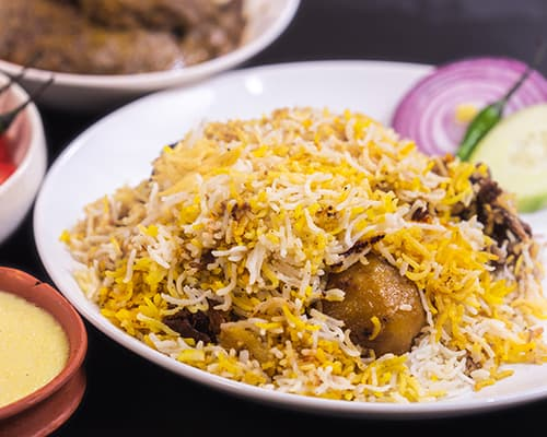 Kolkata Biriyani is mainly famous for its extraordinary flavors which you can relish with onions, raita and even other preparations of chicken. Biriyani here does not particularly require any gravy but you can also order any chicken or mutton preparation that will go with it