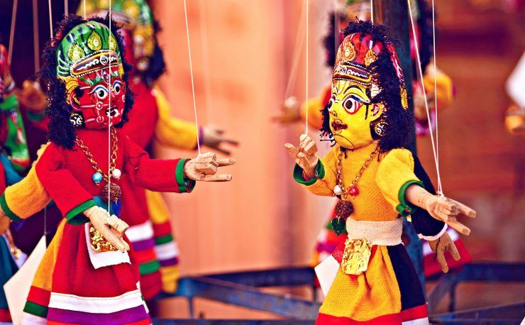 Indian Puppetry or Kathputli is a string puppet theatre, native to Rajasthan, India, and is the most popular form of traditional Indian arts. Being a string marionette, it is controlled by a single string that passes it from the top of the puppet over the puppeteers.