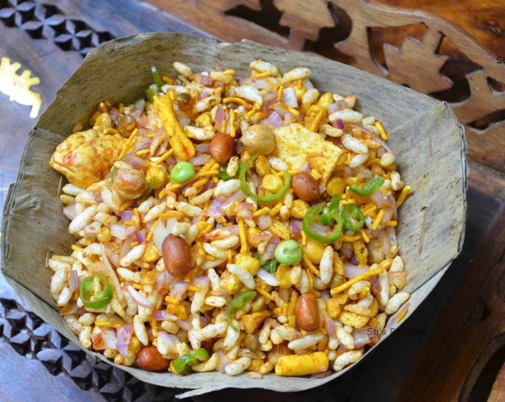 Jhal-muri is a type of mixture prepared with puffed rice , onions, chutney and other ingredients. A packet of Jhalmuri can cost Rs. 20 (average) through price differs according to places.
