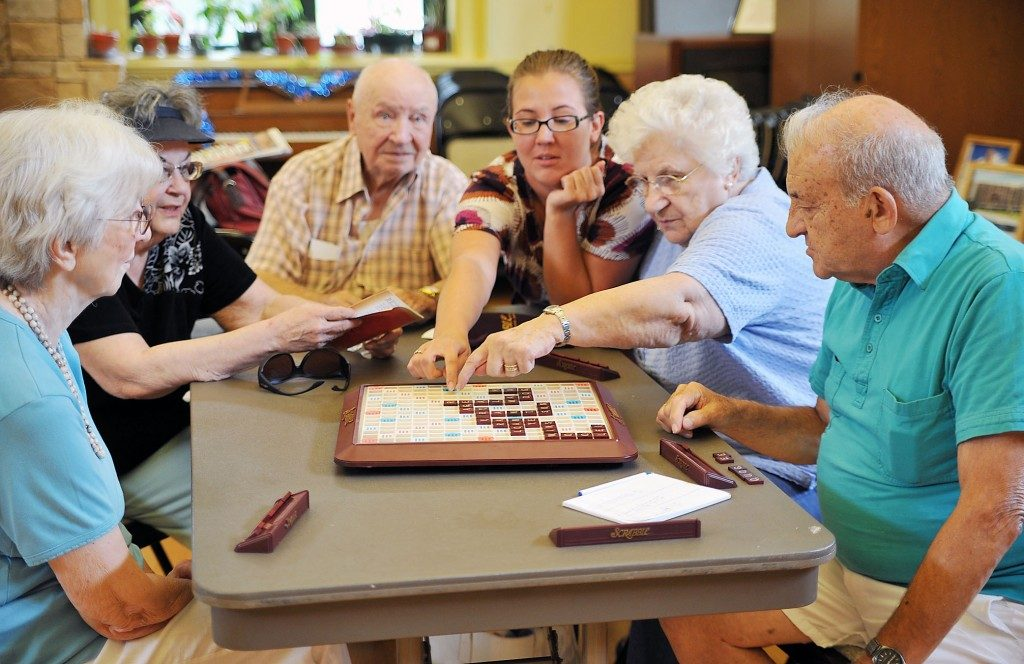 Old aged group playing board game
