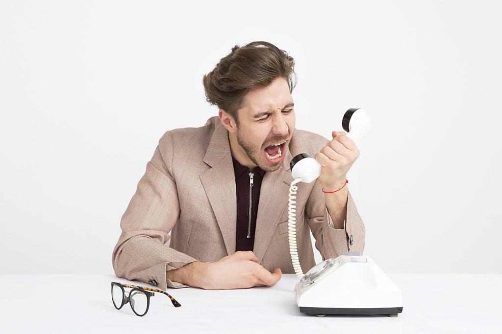 man shouting on call