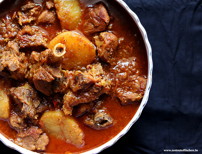 This is the picture of Bengali style mutton (red meat) curry along with lots of oil and Aloo. It can be served with Plain Rice or Fried Rice, Pulao and even rotis.