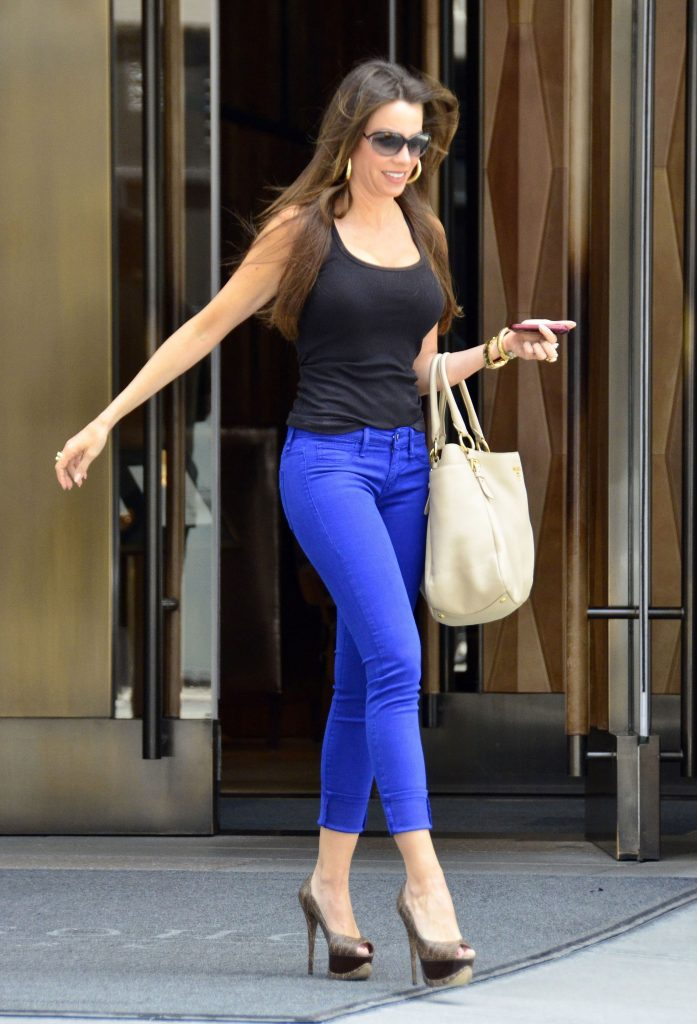 a girl with high rise jeans and high heels