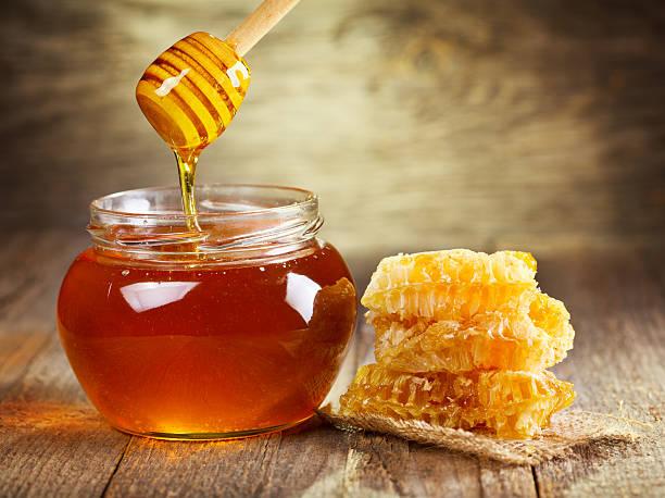 honey jar on a wodden table